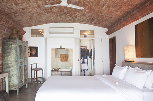 A bedroom at Ahila By The Sea.