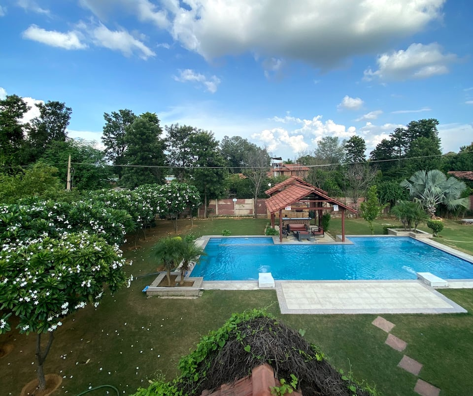 A farmhouse near Gurgaon has a beautiful pool and garden.